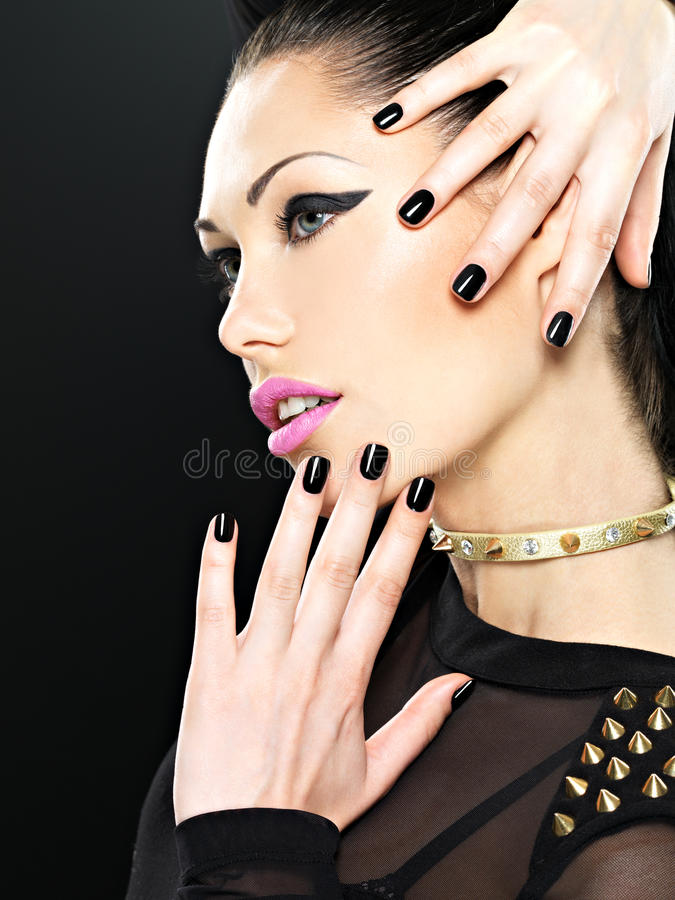Beautiful face of fashion woman with black nails and bright make. Up. stylish girl with bracelet thorns on the neck stock photos
