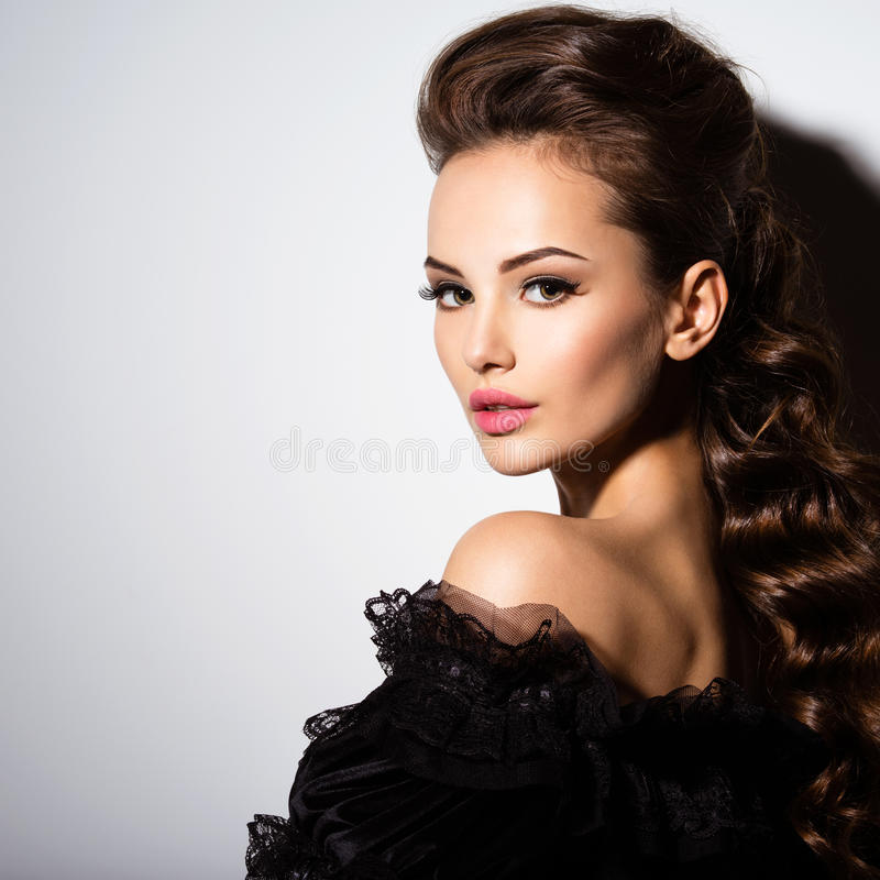 Free Beautiful Face Of An Young Woman In Black Dress Stock Photos - 58722783