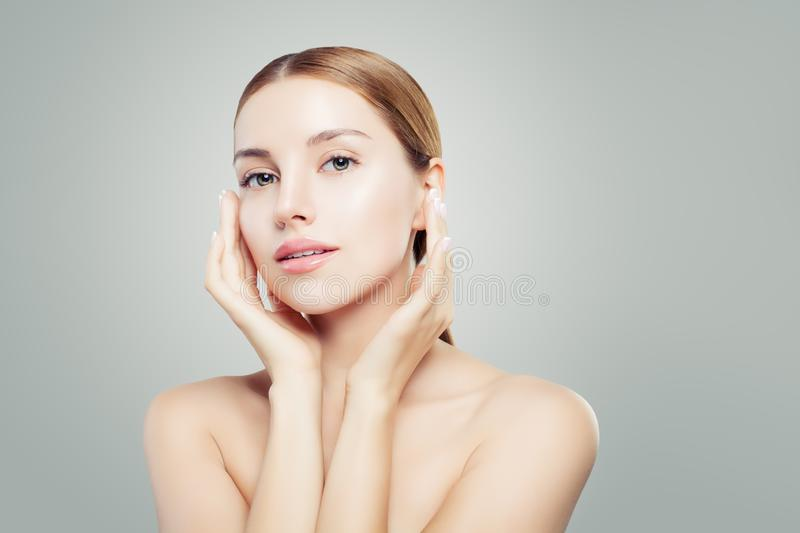 Beautiful face. Perfect woman with clear skin close up portrait. Facial treatment and cosmetology concept stock images