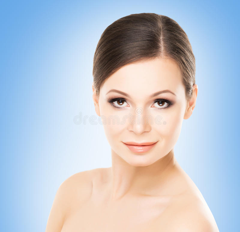 Beautiful face of s young and attractive woman stock image