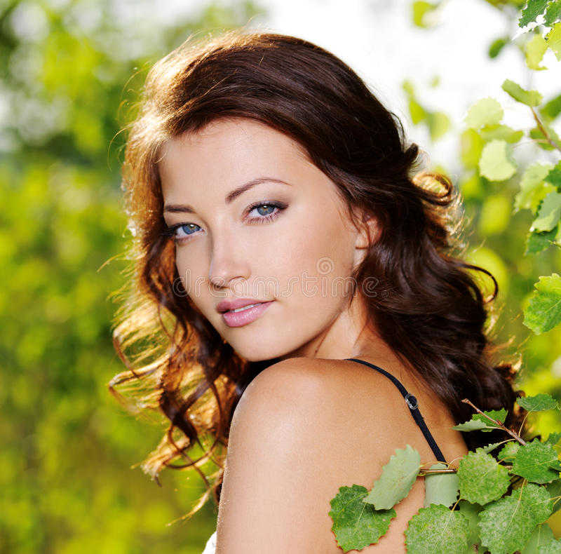 Beautiful face of the woman on the nature stock photos