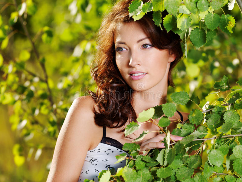 Beautiful face of the woman on the nature royalty free stock image