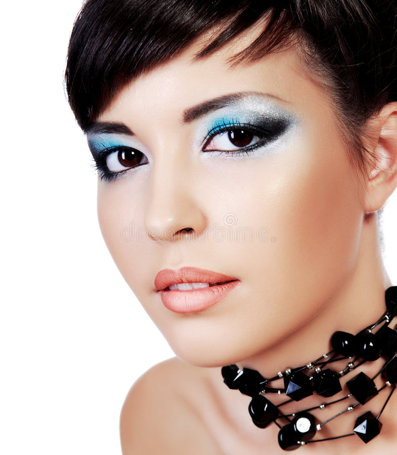 Beautiful face with stylish fashion eye make-up. royalty free stock photo