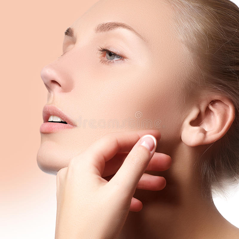 Beautiful face of young adult woman with clean fresh skin - . Beautiful girl with beautiful makeup, youth and skin care stock photo