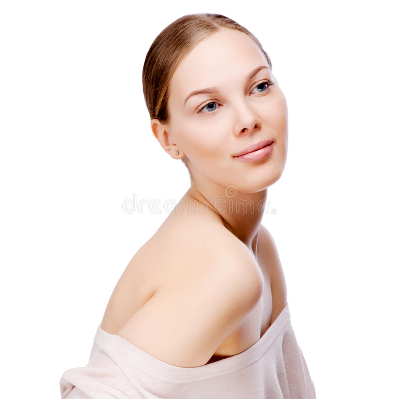 Beautiful face of young adult woman with clean fresh skin - isolated on white. Beautiful face of young adult woman with clean fresh skin stock image