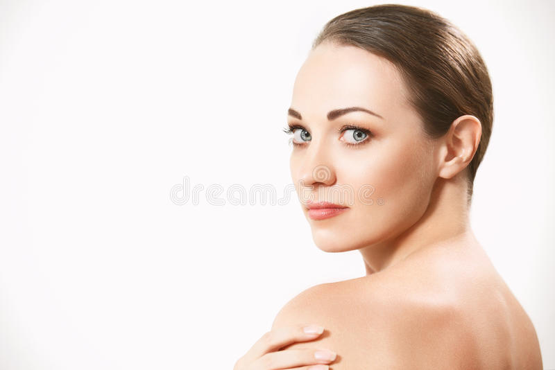 Beautiful face of young adult woman with clean fresh skin. stock photography