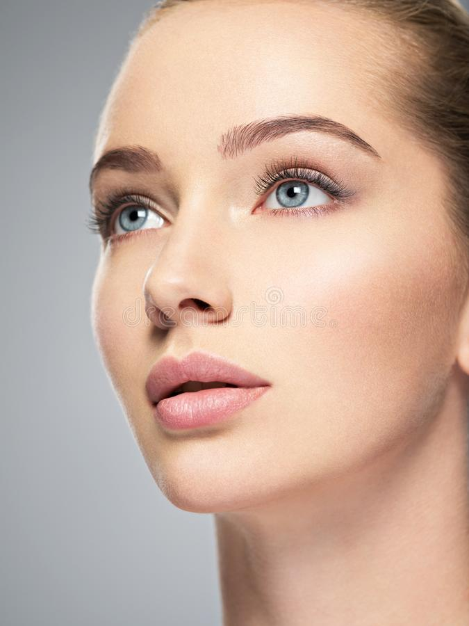 Beautiful face of young woman with perfect skin stock photo
