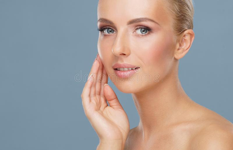 Beautiful face of young and healthy woman. Skin care, cosmetics, makeup, complexion and face lifting. royalty free stock image