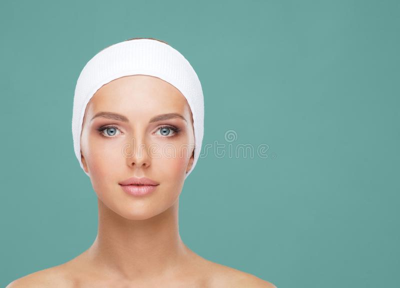 Beautiful face of young and healthy woman. Skin care, cosmetics, makeup, complexion and face lifting. royalty free stock images