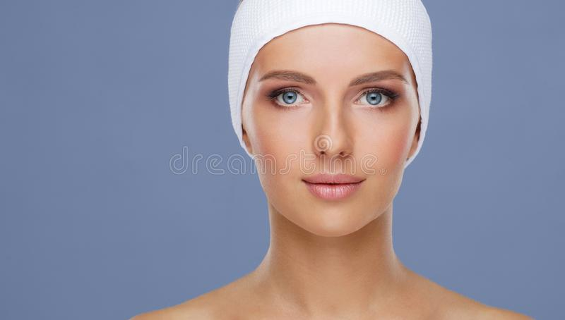Beautiful face of young and healthy woman. Skin care, cosmetics, makeup, complexion and face lifting. royalty free stock photo