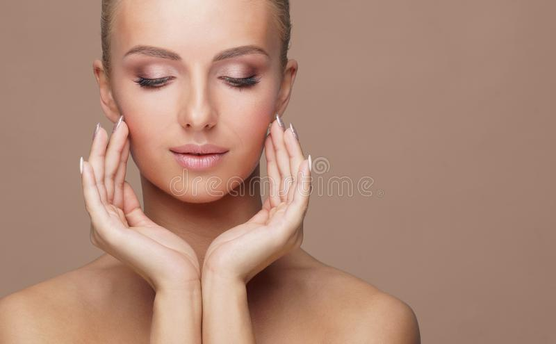 Beautiful face of young and healthy woman. Skin care, cosmetics, makeup, complexion and face lifting. royalty free stock photography
