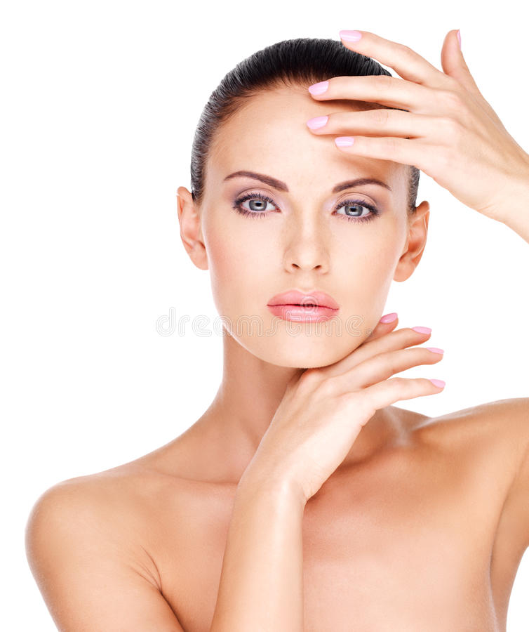 Beautiful face of the young pretty woman with fresh skin stock photos