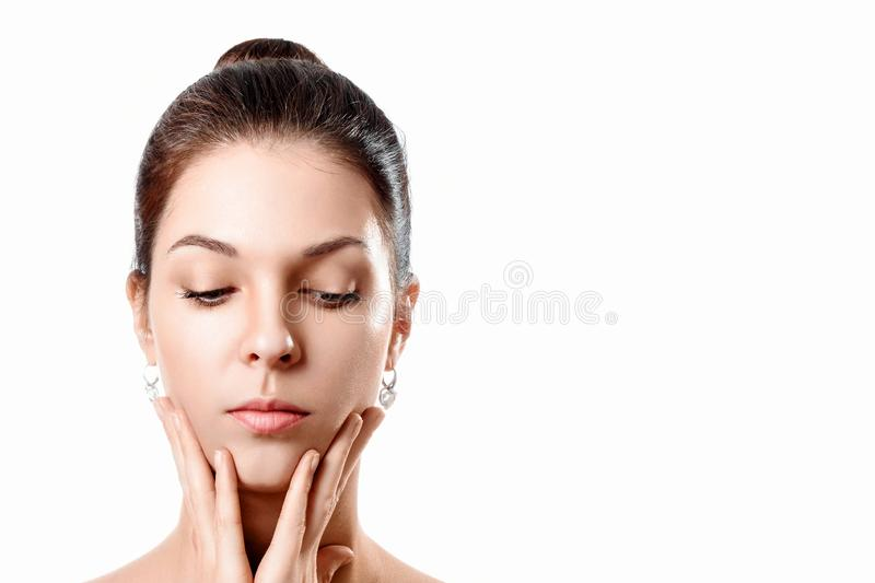 Beautiful Face of Young Woman with Clean Fresh Skin close up isolated on white. Beauty Portrait. Beautiful Spa Woman Smiling. stock photo