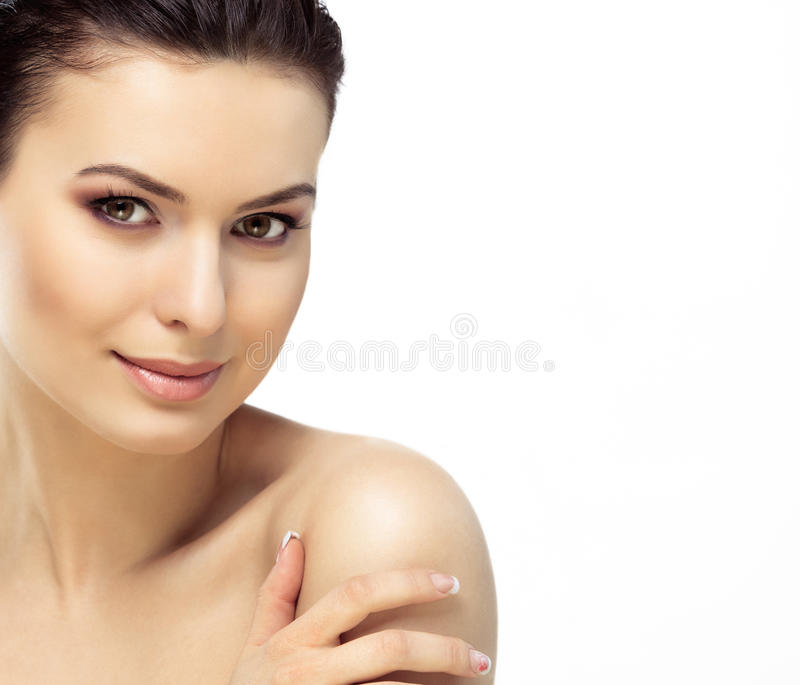 Beautiful Face of Young Woman with Clean Fresh Skin royalty free stock photos