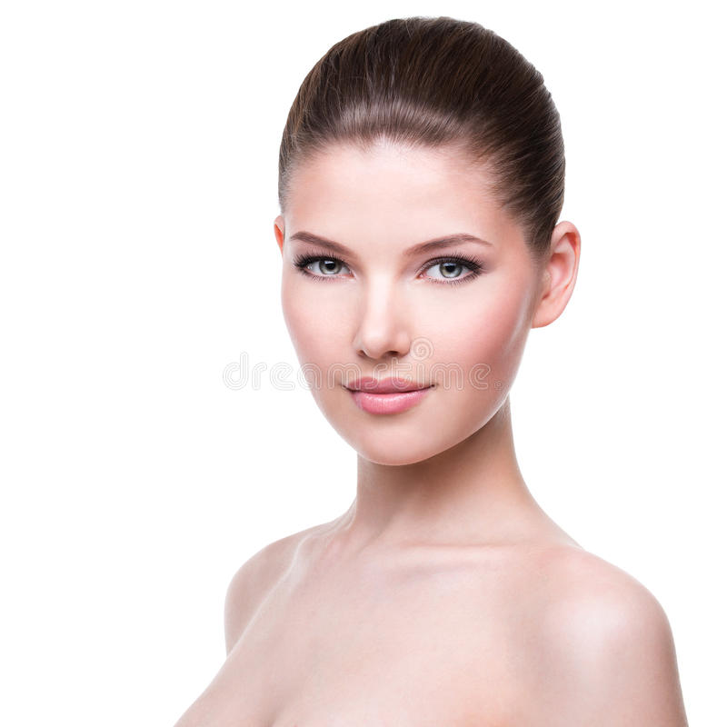 Beautiful face of young woman. stock photo