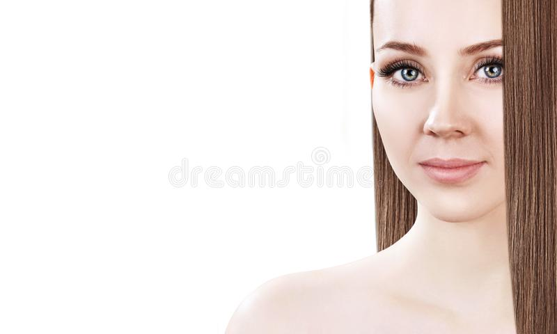 Beautiful face of the young woman with long brown hair. stock photo