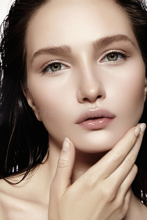 Beautiful Face of young Woman. Skincare, Wellness, Spa. Clean soft Skin, Fresh look. Natural daily makeup, wet hair stock photography