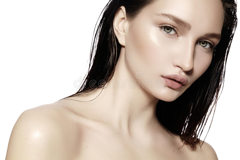 Beautiful Face of young Woman. Skincare, Wellness, Spa. Clean soft Skin, Fresh look. Natural daily makeup, wet hair stock image