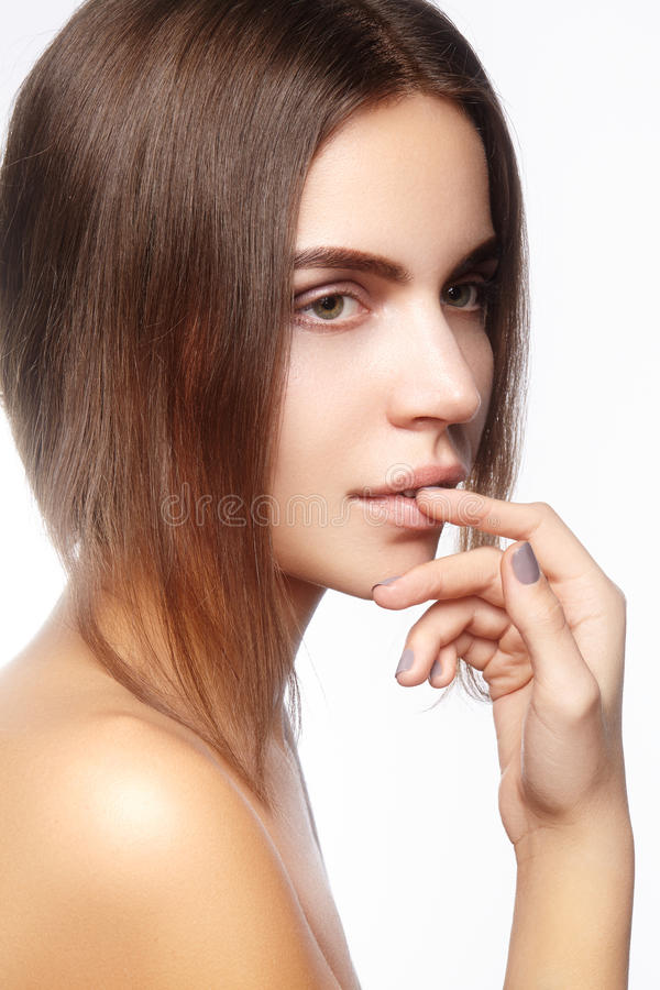 Beautiful face of young woman. Skincare, wellness, spa. Clean soft skin, healthy fresh look. Natural daily makeup.  stock photography