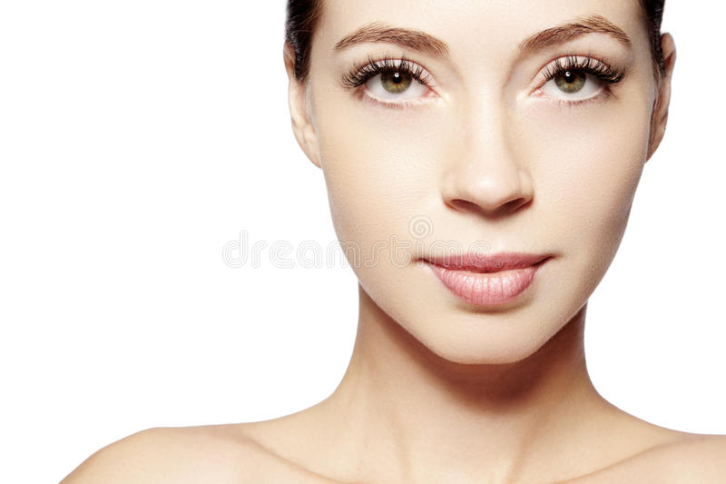 Beautiful face of young woman. Skincare, wellness, spa. Clean soft skin, healthy fresh look. Natural daily makeup.  stock image