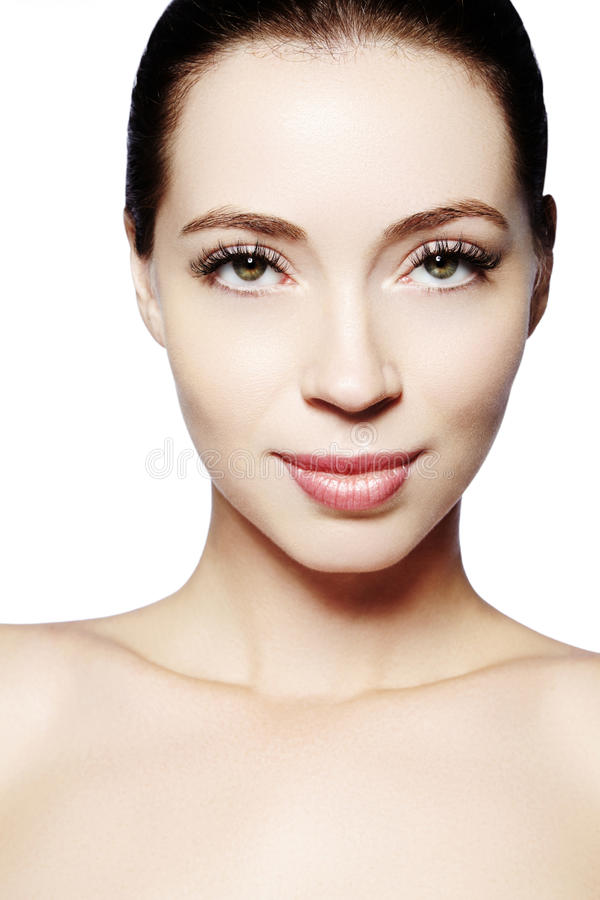 Beautiful face of young woman. Skincare, wellness, spa. Clean soft skin, healthy fresh look. Natural daily makeup.  royalty free stock images