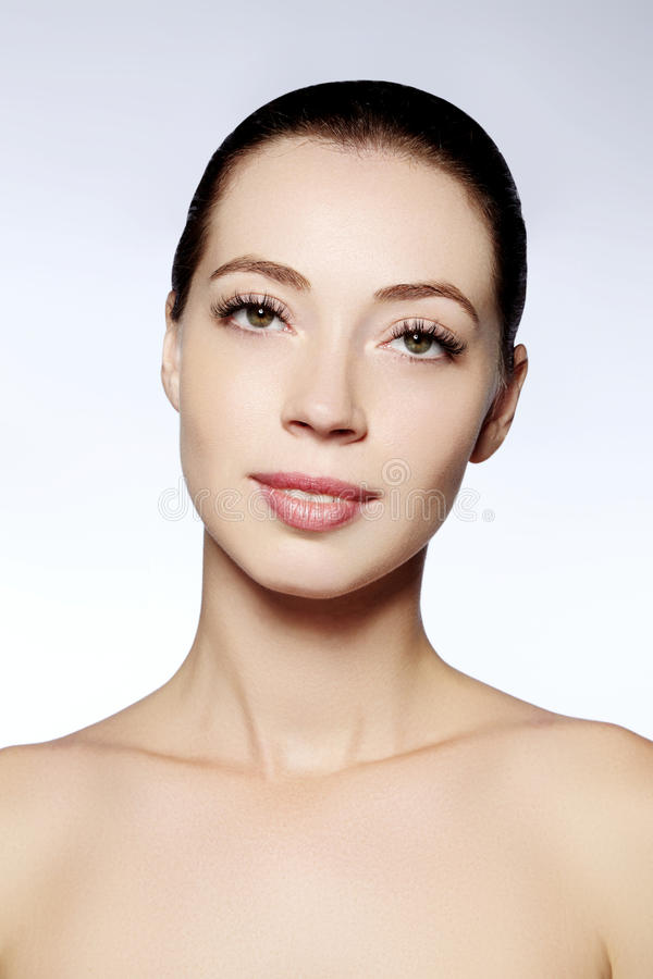 Beautiful face of young woman. Skincare, wellness, spa. Clean soft skin, healthy fresh look. Natural daily makeup.  royalty free stock photos