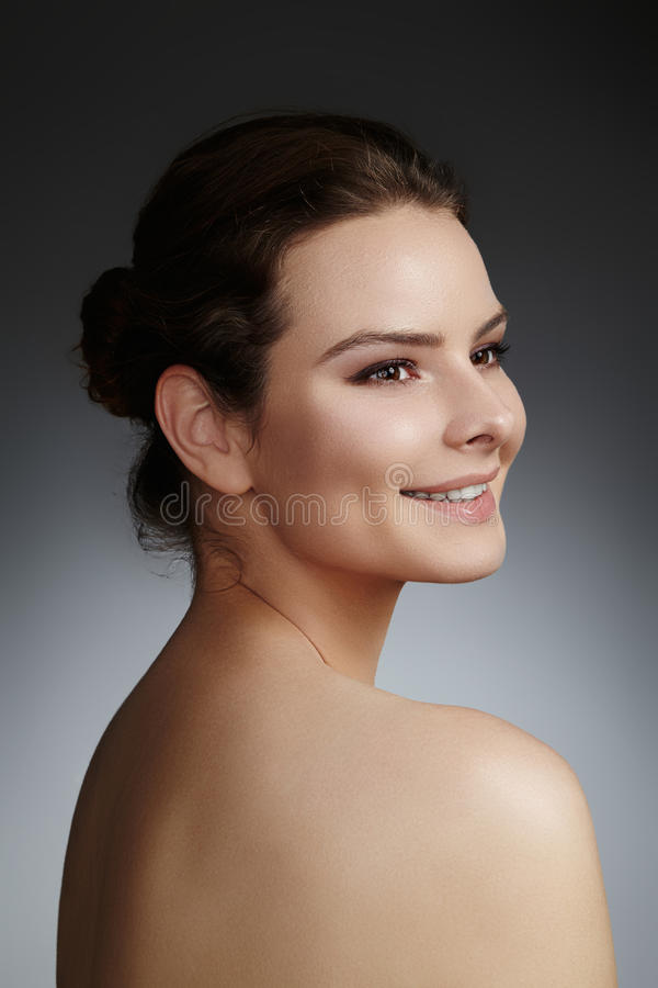 Beautiful face of young woman. Skincare, wellness, spa. Clean soft skin, healthy fresh look. Natural daily makeup.  royalty free stock photo