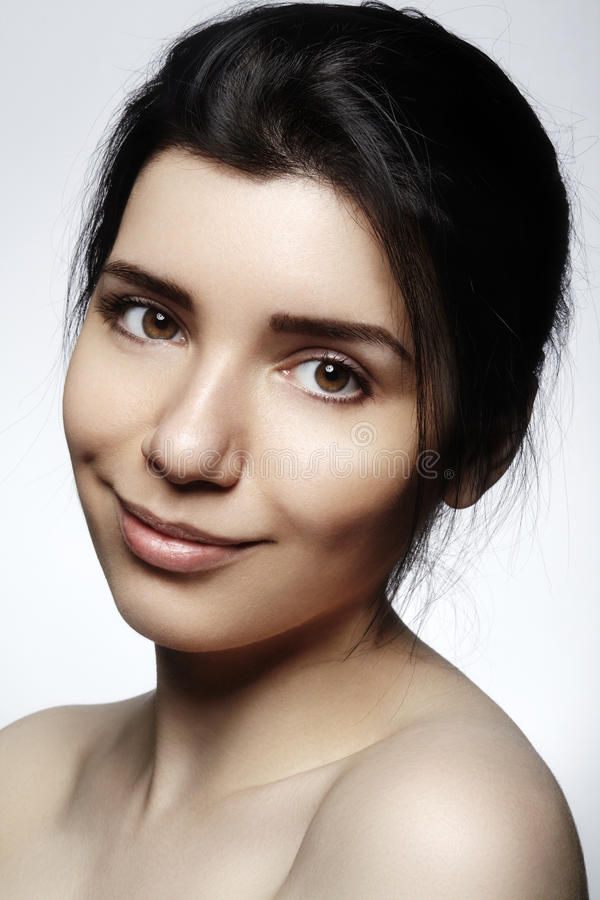 Beautiful face of young woman. Skincare, wellness, spa. Clean soft skin, healthy fresh look. Natural daily makeup.  stock images