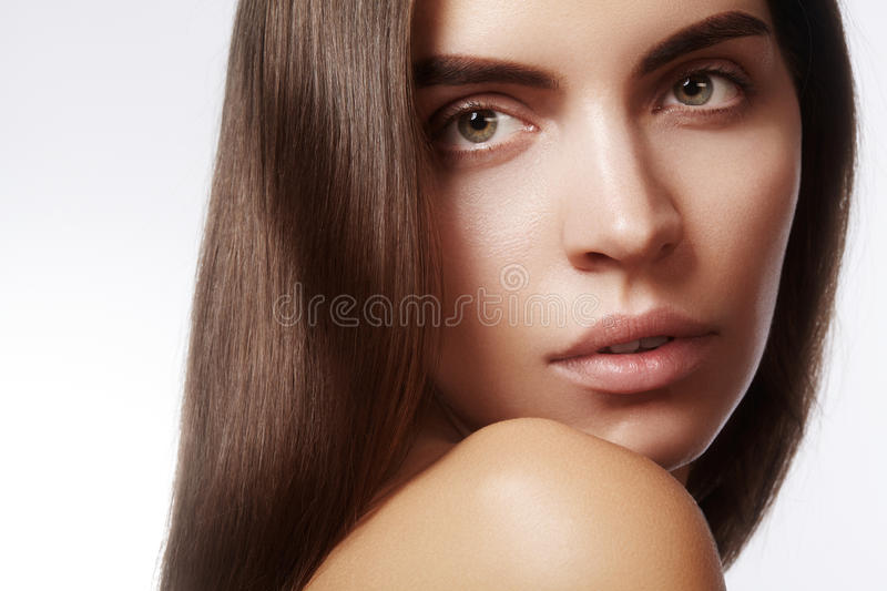 Beautiful face of young woman. Skincare, wellness, spa. Clean soft skin, healthy fresh look. Natural daily makeup.  stock photo