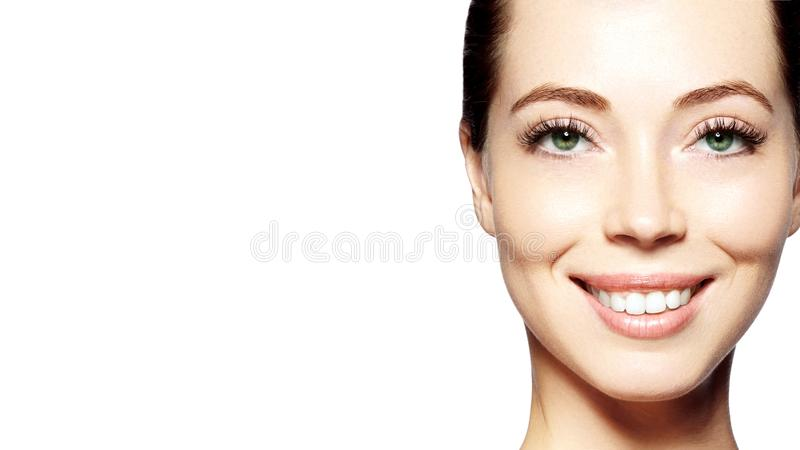 Beautiful face of young woman. Skincare, wellness, spa. Clean soft skin, healthy fresh look. Natural daily makeup. Happy smiling woman stock images