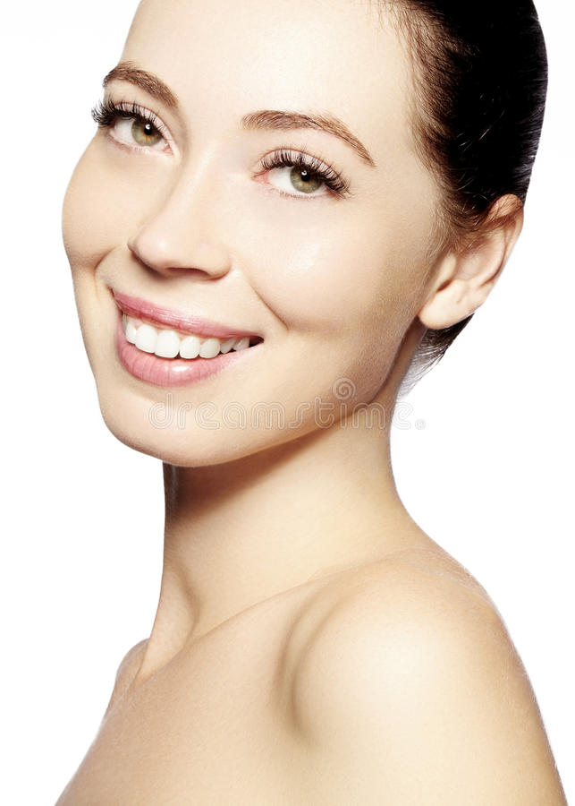Beautiful face of young woman. Skincare, wellness, spa. Clean soft skin, healthy fresh look. Natural daily makeup. Happy smiling woman stock photography
