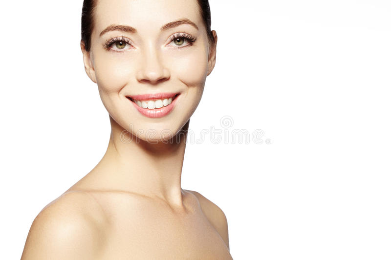 Beautiful face of young woman. Skincare, wellness, spa. Clean soft skin, healthy fresh look. Natural daily makeup. Happy smiling woman royalty free stock images