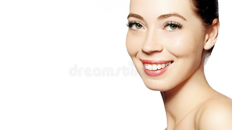 Beautiful face of young woman. Skincare, wellness, spa. Clean soft skin, healthy fresh look. Natural daily makeup. Happy smiling woman stock photos