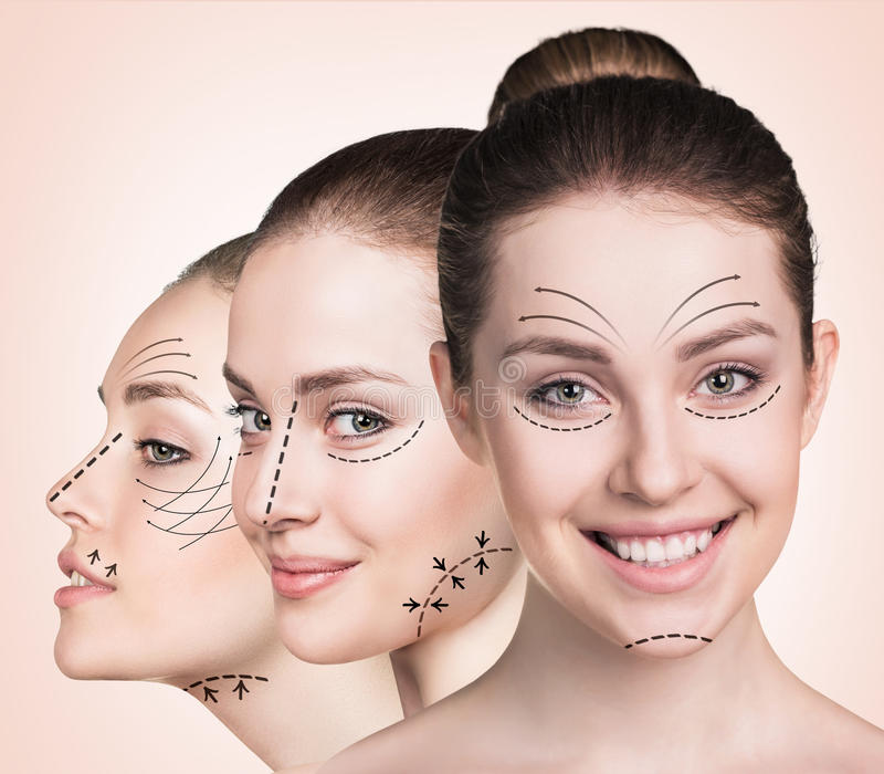 Beautiful faces of young woman. Anti aging treatment and plastic surgery concept. Beautiful faces of young woman with arrows over biege background stock photography