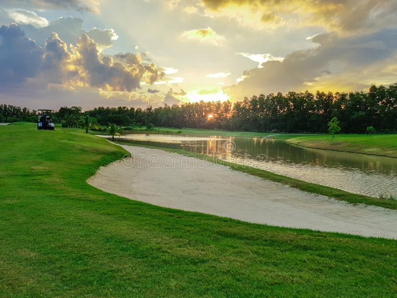 Beautiful fairway sand bunkers and lake in the golf course royalty free stock images