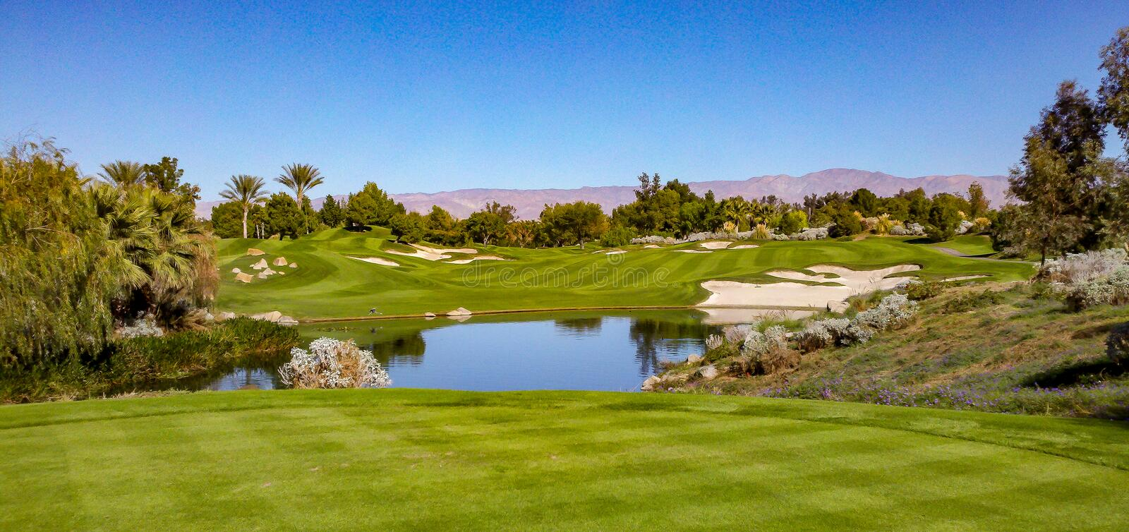 Beautiful Fairway At Indian Wells Golf Course Near Palm Springs. Beautiful fairway view at Indian Wells Golf Course near Palm Springs with mountains, blue skies stock photos
