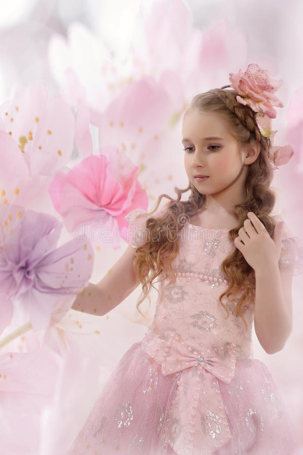 Beautiful fairy girl in a flowering garden royalty free stock photo
