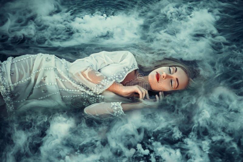 Beautiful Fairy on the lake. royalty free stock image