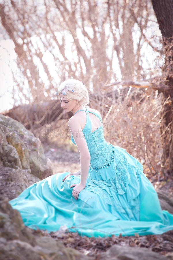 Beautiful fairy in a long turquoise dress royalty free stock photos