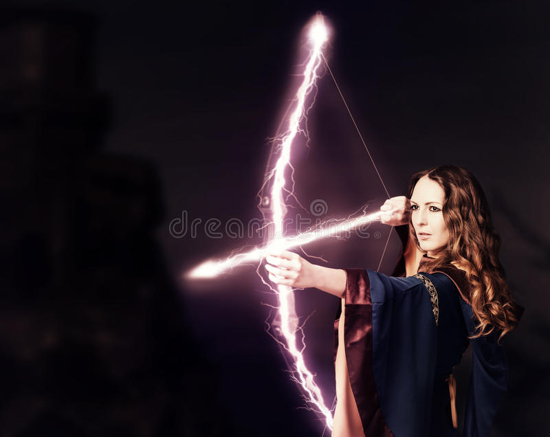 Beautiful fairy woman archer with a magic bow royalty free stock photos