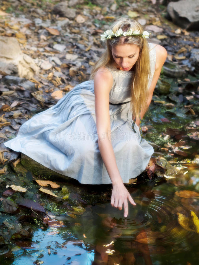 Beautiful Fairytale Princess Sitting By Water Pond royalty free stock photography