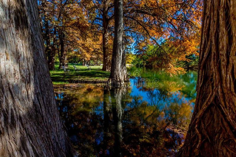 Beautiful Fall Foliage Reflected on the Guadalupe River, Texas. Autumn Landscape of Beautiful Fall Foliage Reflected on the Clear Guadalupe River, Texas stock images