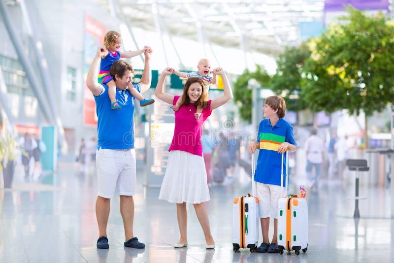 Beautiful family at the airport stock photos