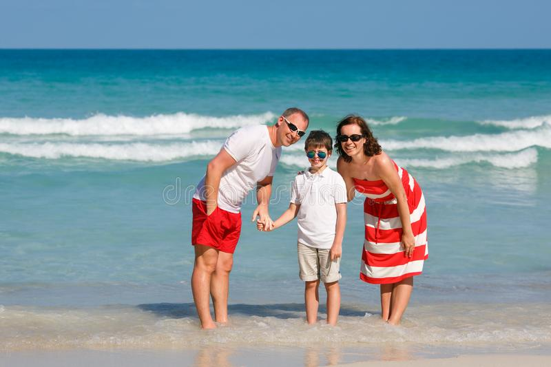 Beautiful family at beach making a self portrait stock image