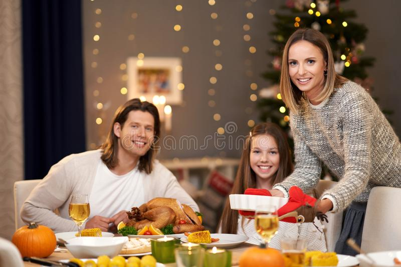 Beautiful family eating Christmas dinner at home royalty free stock photos