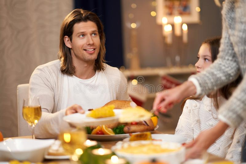 Beautiful family eating Christmas dinner at home stock photography