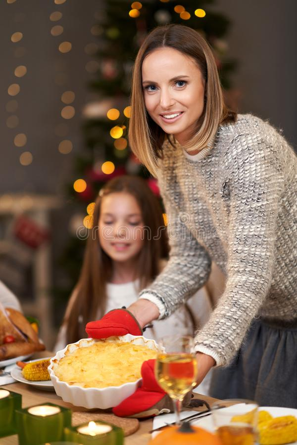 Beautiful family eating Christmas dinner at home royalty free stock photo