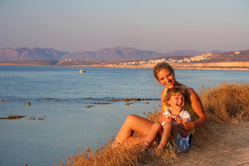 Beautiful family enjoying the evening on beach stock images