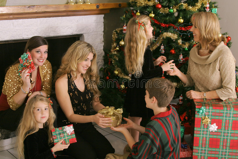 Beautiful family exchanging presents