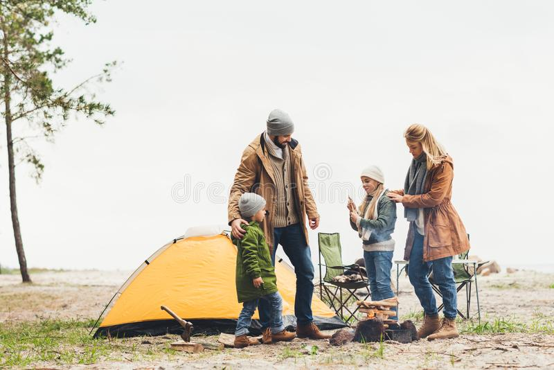 beautiful family having camping trip on cold royalty free stock image